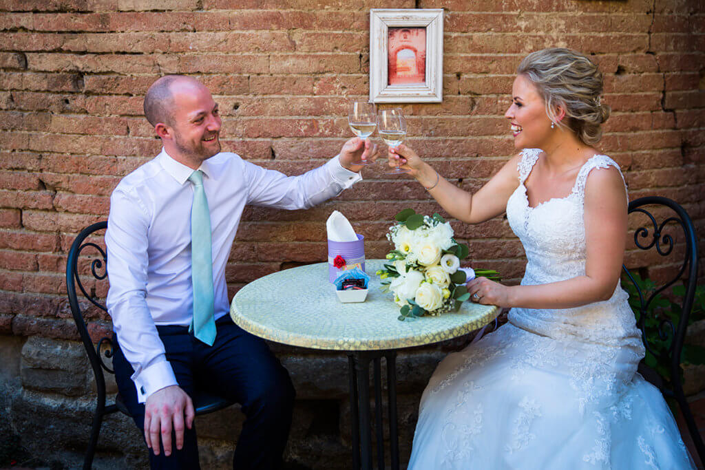 The newlyweds have a toast after the ceremony