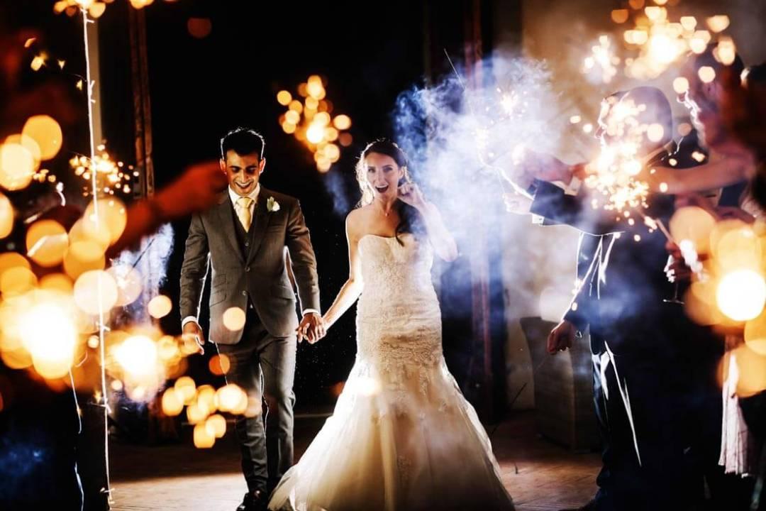 Jane & Aimun walk through the sparkles