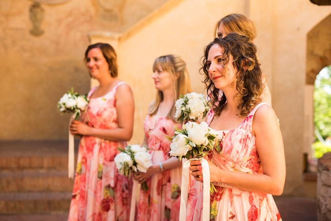 Bridesmaid listen to registrar speech during the ceremony