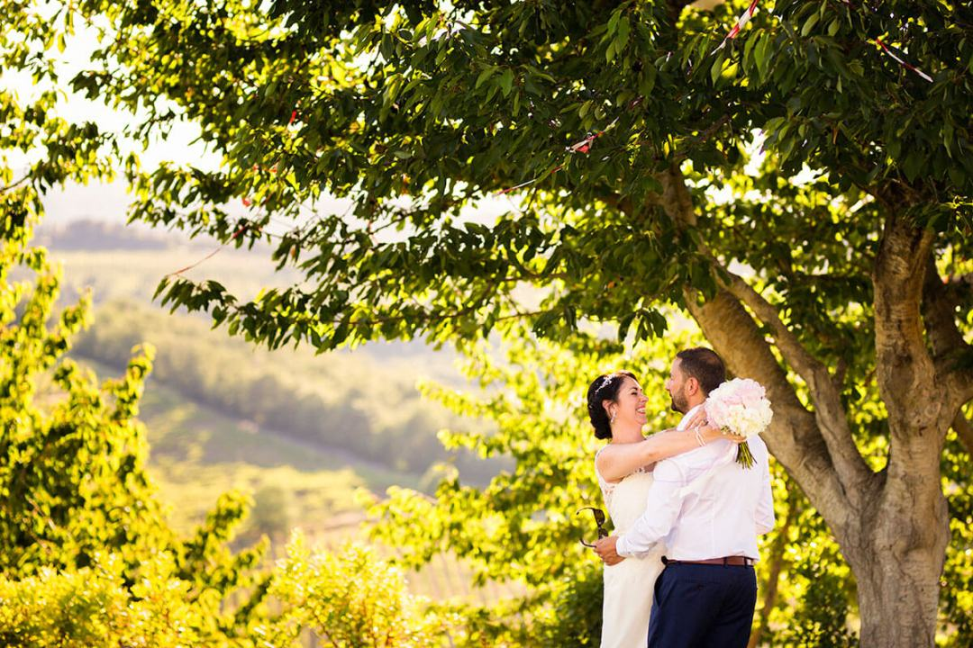 Anya & James hug each other after the ceremony