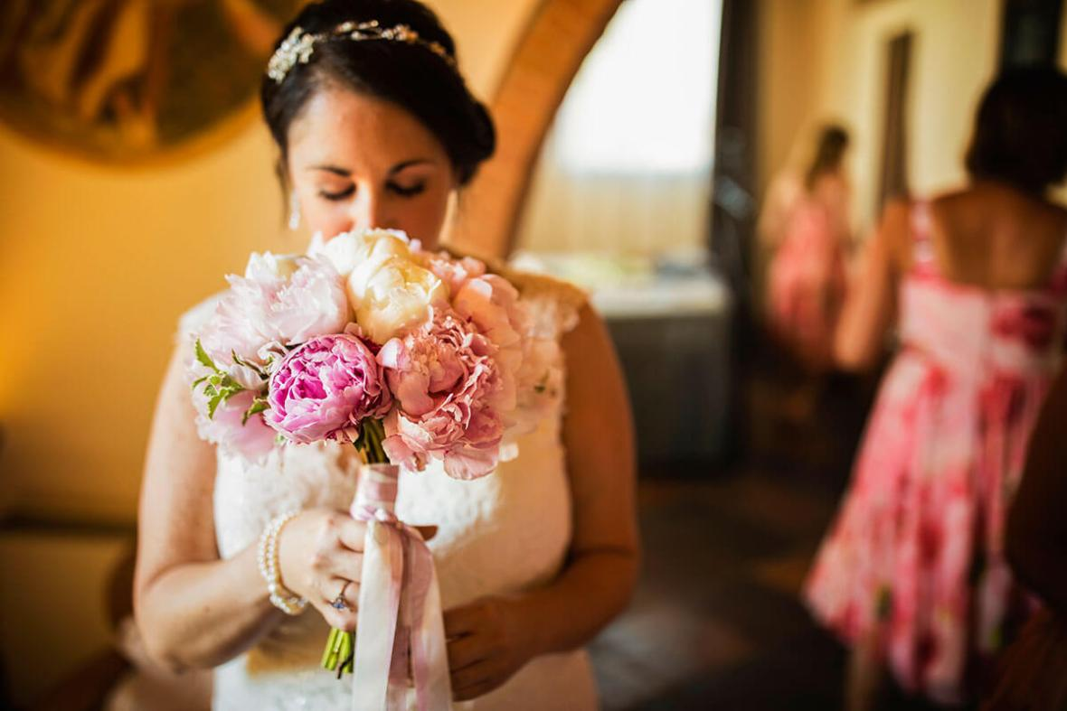 The bride smells her bouquet