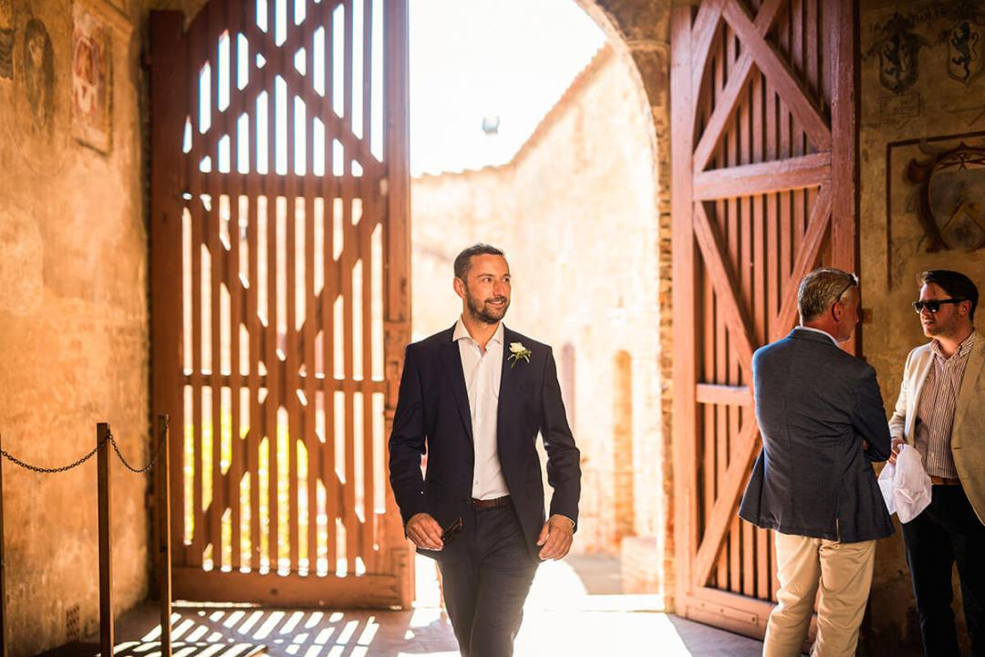 The groom arrives at the location of the ceremony