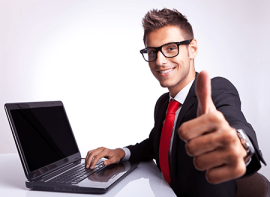 man with glasses at laptop thumbs up
