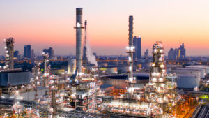 Aerial view of oil refinery during sunrise.