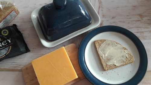 Buttered Oatcake on a plate ready for some Orkney Cheese