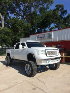 Completely custom 2008 GMC Sierra 2500 with Custom Molded Headlights and Bumper.