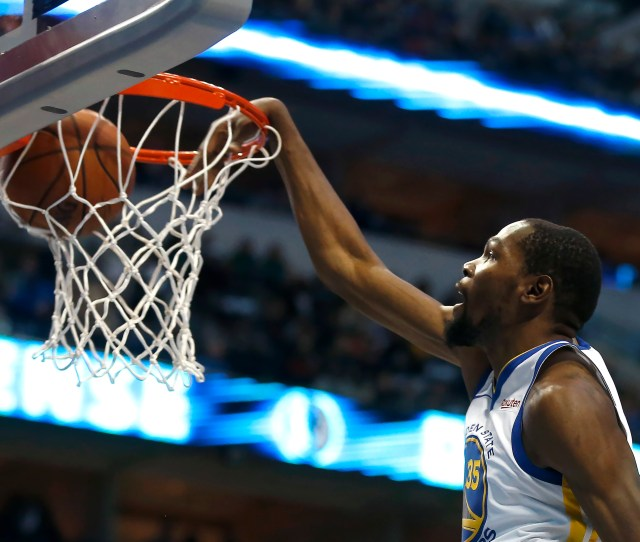 Golden State Warriors Forward Kevin Durant 35 Slam Dunks Against The Dallas Mavericks During The First Half Of An Nba Basketball Game Saturday Nov