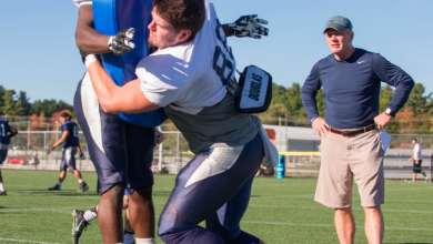 Photo of Football Players Experience Fewer Spine, Head Injuries In Helmet-Less Training Program: Study
