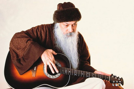 Osho playing the guitar