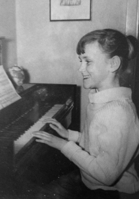 The future songstress practicing piano at age ten.