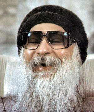 Osho laughing during discourse