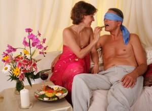 Couple feeding each other