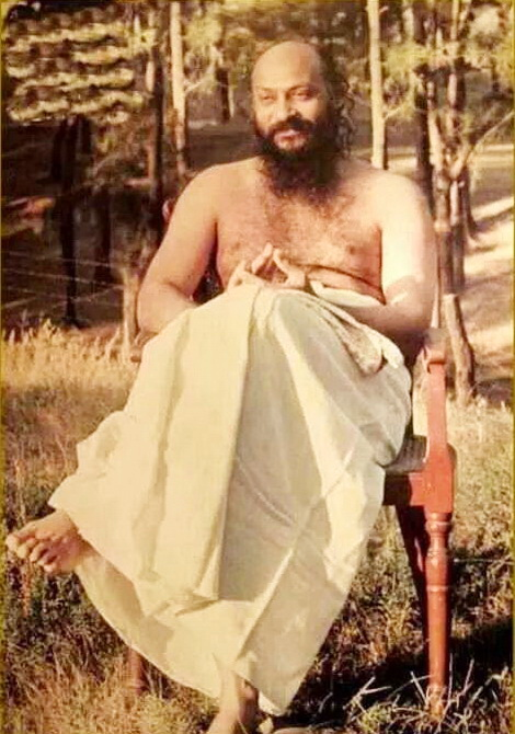 Osho sitting in forest
