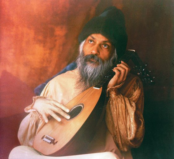 Osho playing lute