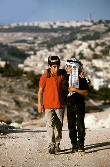 jewish and Muslim child walking together