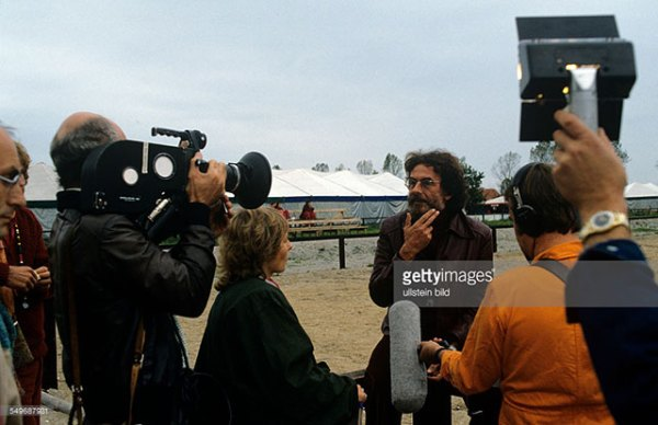 caption: Journalist Joerg Andrees Elten, Bhagwan disciple, giving a TV interview