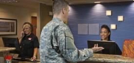 A soldier checks into a hotel