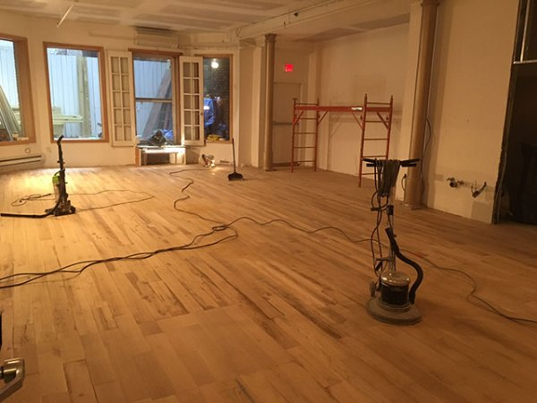 Sanding the floor of the meditation hall