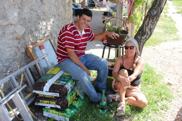 Uma with Miguel, the two guardians of the 'Earthship'