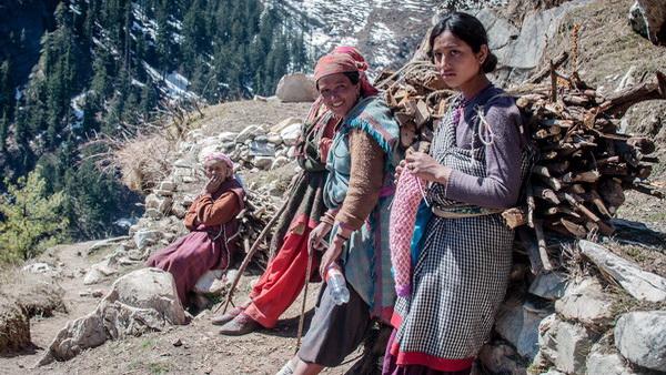 Village women carrying firewood