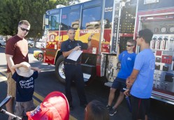 Oceanside Fire Department Captain, David Parsons explains the mathematics of being a fire department engineer to Joe (5) and Jack Pelican with Carlo Silva and Ethan Parsons.
