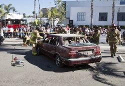 Oceanside firefighters show a crowd attending Sundays open house, the tools they use for extricating people from vehicles involved in accidents.