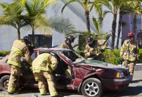 Oceanside firefighters make quick work of door removal on a four door Volvo during an demonstration at the open house.