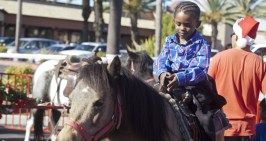 4 year old Trey, takes a pony ride.
