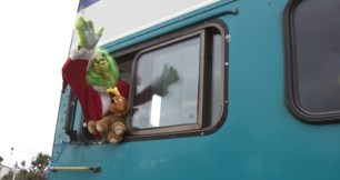 The Grinch joined the Clauses on the round trip train ride to Sorrento Valley