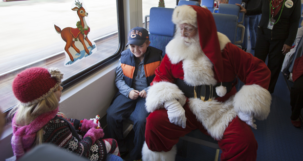 Santa chats with Natalia and Dominic Marchese of Temecula.