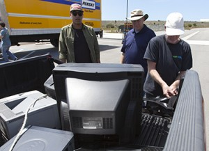 "Austin Malott and Hank Ardens unload ""e-waste"" donated by Shawn Olson"