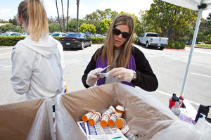 Jill Pogue with the U.S. Probation Office sorts through prescription medications dropped of at Tri City Hospital during National Drug Take Back Day. (file photo)