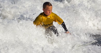 Determination on the face of Earl Warren Middle School surfer, Andy Schade