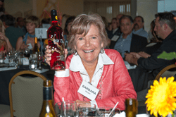 "After winning the bid on the last available bottle of award-winning Wild Thing wine, Barbara Harper laughs as she acknowledges, ""I don't even drink Rosé!"" (courtesy photo)"