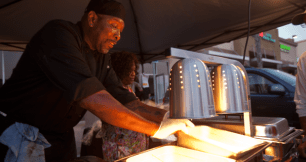 Walter Crittle and Vanessa Webster dishing up the food at Felix's BBQ with Soul