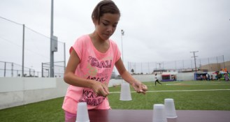 Kayla, 12 in a cup stacking contest