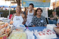 Viersa Ferrell and Curtis Craig with Silvia Spears (center) Executive Director Oceanside Senior Citizens Nutrition Program had unbelievable prices on their baked good for sale at the festival