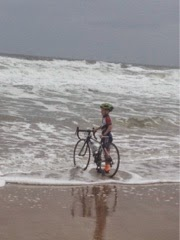 CJ dips his bike in the Atlantic Ocean at he end of his cross-country ride(courtesy photo)
