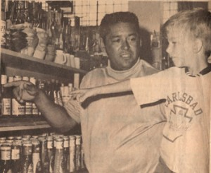 1973 Board President Tony Mata, Sr. shops for supplies with a young Club member (courtesy photo)