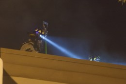 Firefighters looking for the source of the smoke on the roof of the restaurant.