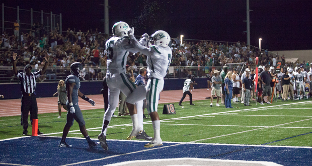 Daiquan Cook celebrates with Anthony Martinez after scoring the first touchdown of the 2015 season for the Pirates