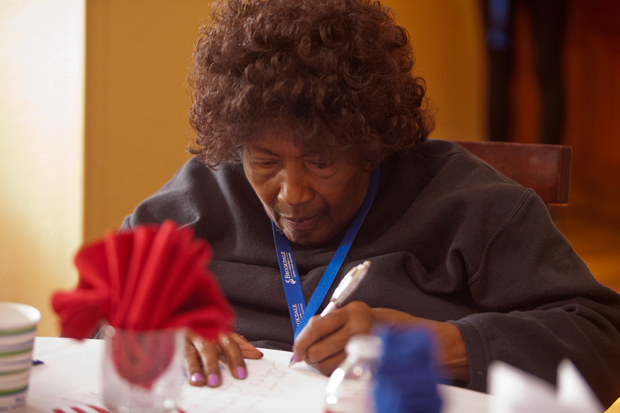Brookdale resident, Grace Hughes, writes a thank yo card to the veterans residing at the facility.