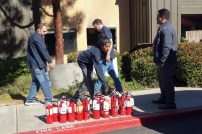 Mission Gate employees gather fire extinguishers they used prior the fire department arrival.