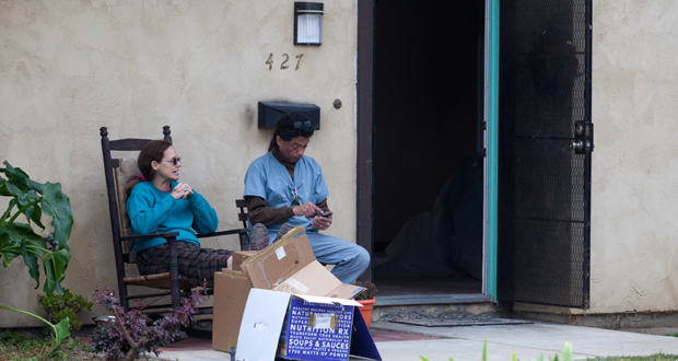 Kathy and Carlos Cervantes outside their home after fire was extinguished.