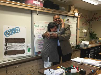 Superintendent Duane Coleman surprising Alma with the good news.