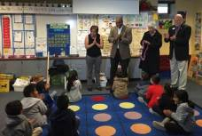 """TOY Elena Morales being surprised by Superintendent Duane Coleman, Board members Emily Wichmann Ortiz and Robert """"Camo"""" Gleisberg in front of her kinder class."""