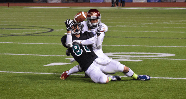 Jake Gerardi makes a grab on 4th-12 to keep a late first half drive alive.