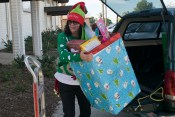 Cathy Nykiel unloads gifts for the kids