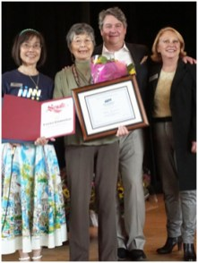 Charlotte Fan, Yasuko Zimmermann, Jason Levine of Dos Gringos, a flower Company, and Debbie Case honoring Yasuko Zimmermann for 35 years of delivering Meals to seniors
