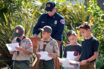 Tristan, age 9, Hudson, 9, Desmond, 10 and Manuel 12 read about the history of Old Glory